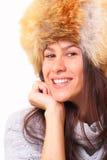 Joyful brunette woman in a fur hat. Joyful young brunette woman in a fur hat Royalty Free Stock Photos