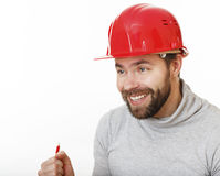Joyful builder in helmet. Royalty Free Stock Photography