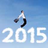Joyful business person flying on the sky Stock Images