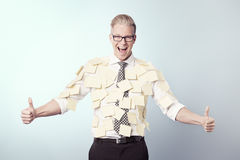 Joyful businessman with blank stickers attached to his shirt. Royalty Free Stock Photos