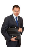 Joyful businessman with a briefcase. Stock Photos