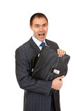 Joyful businessman with a briefcase. Royalty Free Stock Image