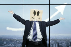 Joyful businessman with cardboard head Stock Images