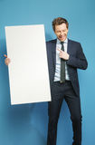 Joyful businessman carrying the white board Stock Image