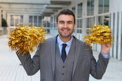 Joyful businessman cheering up with pompoms.  Stock Photography