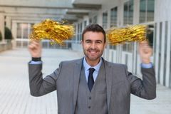 Joyful businessman cheering up with pompoms.  Royalty Free Stock Photo