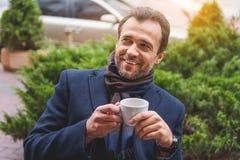 Joyful businessman enjoying hot beverage Royalty Free Stock Photos