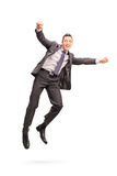Joyful businessman jumping in the air Royalty Free Stock Image