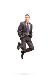Joyful businessman jumping out of happiness Stock Photos