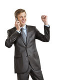 Joyful businessman with phone Royalty Free Stock Image