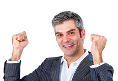 Joyful businessman punching the air in celebration Stock Image