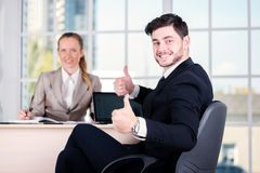 Joyful businessmen. Two businessman sitting at the table until o Royalty Free Stock Photography