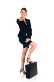 Joyful businesswoman. Young attractive joyful businesswoman.  studio shot, white background Royalty Free Stock Photos