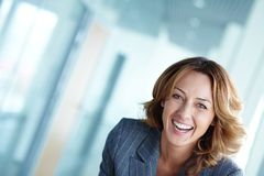 Joyful businesswoman. Image of happy businesswoman looking at camera Royalty Free Stock Images