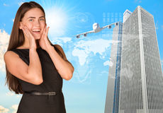 Joyful businesswoman in dress. Airplane, skyscrapers and world map as backdrop Royalty Free Stock Image