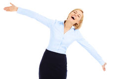 Joyful businesswoman. A picture of a young happy businesswoman dancing over white baclground Royalty Free Stock Image