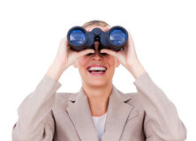 Joyful businesswoman predicting future. Success through binoculars isolated on a white background Stock Image