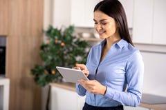 Joyful businesswoman using her tablet stock images