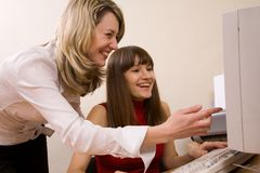 Joyful businesswomen at office stock image