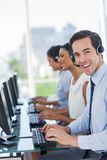 Joyful call centre agent working Stock Photo