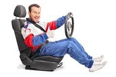 Joyful car racer giving a thumb up Stock Images