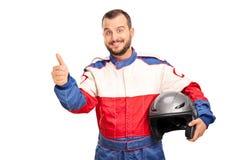 Joyful car racer giving a thumb up Royalty Free Stock Photo