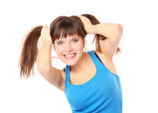 Joyful and cheerful girl clings to her hair Royalty Free Stock Photography