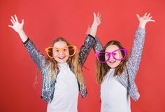 Joyful and cheerful. Sisterhood concept. Friendly relations siblings. Sincere cheerful kids share happiness and love. Girls funny big eyeglasses cheerful smile royalty free stock images