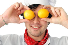 Joyful chef. An image of a joyful chef with lemons Royalty Free Stock Photography