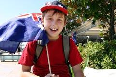 Joyful child flying flag royalty free stock photography