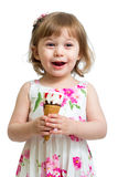Joyful child girl eating ice-cream Royalty Free Stock Photography