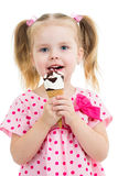 Child girl eating ice cream Royalty Free Stock Images