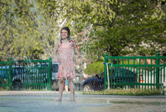 Joyful child girl  having fun in outdoor kids water park Royalty Free Stock Images