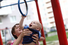 Joyful child hanging on rings Royalty Free Stock Photography