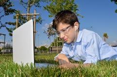 Joyful child and laptop Stock Photo