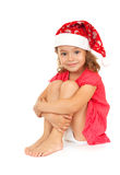 Joyful child in the New Year's cap. Royalty Free Stock Photos