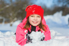 Joyful child playing in snow. happy girl having fun outside winter day stock photography