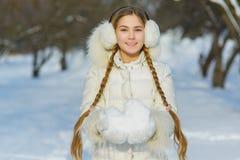 Joyful child playing in snow. happy girl having fun outside winter day stock photos