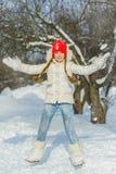 Joyful child playing in snow. happy girl having fun outside winter day stock image