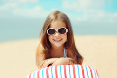 Joyful child resting on the beach in the summer Royalty Free Stock Image