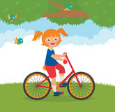 Joyful child rides a bike Stock Images