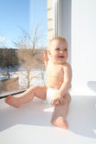 The joyful child on a window sill Royalty Free Stock Images
