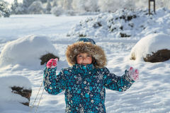 Joyful child in winter park on sunny fresh day Stock Image