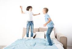 Joyful children entertaining themselves at home stock photos