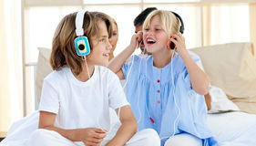 Joyful children having fun and listening music Royalty Free Stock Photo