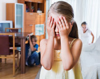 Joyful children hiding from girl with closed Royalty Free Stock Images