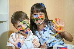 Joyful children with paints on their faces. Children paints faces with colors. Royalty Free Stock Image