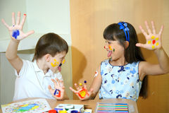Joyful children with paints on their faces. Children paints faces with colors. Stock Photography