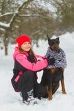 Joyful children playing in snow. Two happy girls having fun outside winter day.  Royalty Free Stock Photo