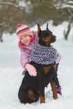 Joyful children playing in snow. Two happy girls having fun outside winter day.  Stock Image